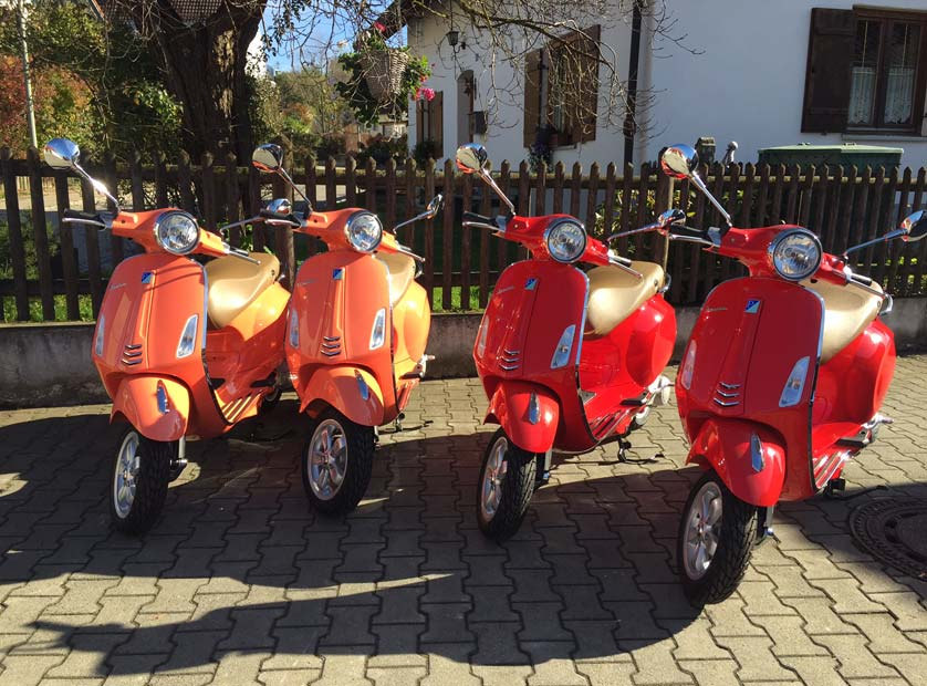 Aktion: Vespa Primavera 50 2T in Rosa Corallo und Rot Dragon